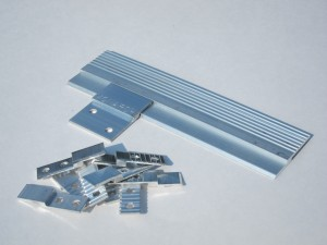 """Monarch 1/2"""" Custom Panel Clip next to continuous length and standard 1.5"""" MF625 Z Clip."""